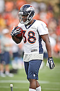 SHOT 7/25/13 9:27:53 AM - Denver Broncos rookie running back Montee Ball #38 runs through drills during opening day of the team's training camp July 25, 2013 at Dove Valley in Englewood, Co.  (Photo by Marc Piscotty / © 2013)