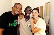 Kwame Mwakio (left) and Gabrielle Fondiller (right) embrace a scholarship student supported by Hatual Likoni, at his home..Kwame overseas scholarship programs for Hatua, Gabrielle founded the foundation..
