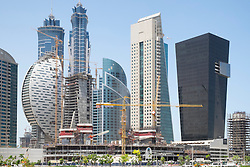 Construction site with many skyscrapers being built in new Business Bay district in Dubai United Arab Emirates