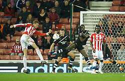 STOKE-ON-TRENT, ENGLAND - Monday, October 31, 2011: Stoke City's Peter Crouch sees his shot blocked by Newcastle United's Demba Ba during the Premiership match at the Britannia Stadium. (Pic by David Rawcliffe/Propaganda)