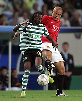 Photo: Paul Thomas.<br /> Sporting Lisbon v Manchester United. UEFA Champions League Group F. 19/09/2007.<br /> <br /> Wes Brown (R) of Utd battles with Joao Moutinho.