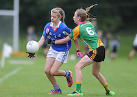 21 Aug 2016: Megan Clarke, left, Meath, in action against Muireann McCague, Monaghan.   Girls U12 Gaelic football final, Skryne, Meath (blue) v Clontibret, Monaghan (green).  2016 Community Games National Festival 2016.  Athlone Institute of Technology, Athlone, Co. Westmeath. Picture: Caroline Quinn