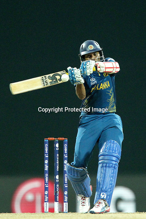 Tilakaratne Dilshan attacks a delivery from Jade Dernbach of England during the ICC World Twenty20 Super Eights match between England and Sri Lanka held at the  Pallekele Stadium in Kandy, Sri Lanka on the 1st October 2012<br /> <br /> Photo by Ron Gaunt/SPORTZPICS