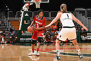 February 25, 2016: Taja Cole #5 of Louisville in action during the NCAA basketball game between the Miami Hurricanes and the Louisville Cardinals in Coral Gables, Florida. The Cardinals defeated the 'Canes 79-51.