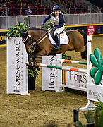 LINDSAY BEER rides Kennystown Frankie in the Horseware Indoor Eventing Challenge at The Royal Horse Show in Toronto, Ontario. Both were eliminated after failing to complete the course due to an obstacle refusal.