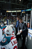 KELOWNA, CANADA - JANUARY 16: Head coach Dan Lambert discusses a play with players on the bench against the Seattle Thunderbirds on January 16, 2015 at Prospera Place in Kelowna, British Columbia, Canada.  (Photo by Marissa Baecker/Shoot the Breeze)  *** Local Caption *** Dan Lambert; Kris Mallette;