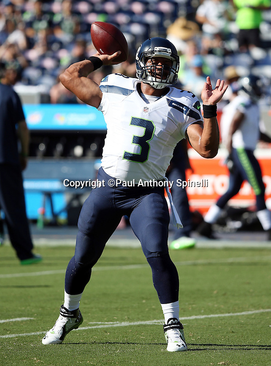 Seattle Seahawks quarterback Russell Wilson (3) throws a pregame pass before the 2015 NFL preseason football game against the San Diego Chargers on Saturday, Aug. 29, 2015 in San Diego. The Seahawks won the game 16-15. (©Paul Anthony Spinelli)
