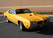 1970 Orbit Orange Pontiac GTO Judge in a Target Parking lot, classic Muscle Car.