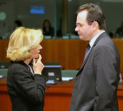 George Papaconstantinou, Greece's finance minister, right, speaks with Elena Salgado, Spain's finance minister, during the meeting of European finance ministers, at EU Council headquarters in Brussels, Belgium, on Tuesday, Feb. 16, 2010. (Photo © Jock Fistick)