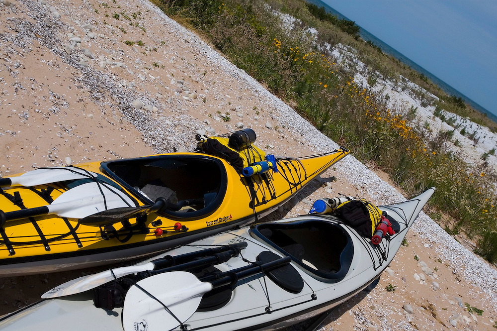 A pair of sea kayaks beached at South Manitou Island in the Sleeping Bear Dunes National Lakeshore near Traverse City Michigan.