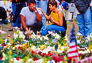 18 SEPTEMBER 2011 - NEW YORK, NY: A weeping man is comforted at a memorial  in Union Square for people killed in the WTC attacks in New York City, Sept 18, 2001. More than 2,900 people were killed when terrorists, thought to be affiliated with Osama bin Laden, hijacked and crashed two passenger jets into the twin towers on the southern tip of Manhattan on Sept 11, 2001. Thousands of memorials for the dead and missing have been built in lower Manhattan, many of them in Union Square. PHOTO BY JACK KURTZ