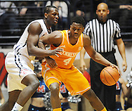 "Tennessee Volunteers forward Armani Moore (4) works against Mississippi Rebels center Dwight Coleby (23) at the C.M. ""Tad"" Smith Coliseum in Oxford, Miss. on Saturday, February 21, 2015. (AP Photo/Oxford Eagle, Bruce Newman)"