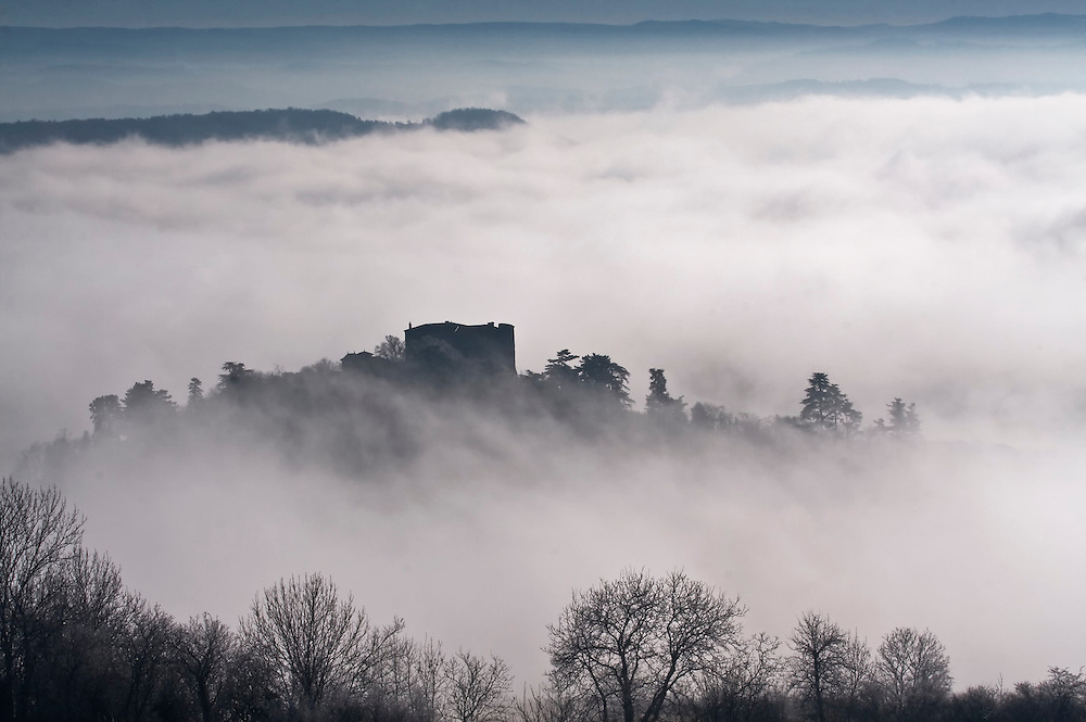 French castle in the mist. Antoingt, Auvergne, Frane