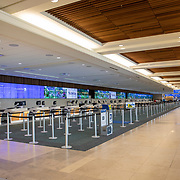 The ticket counters at Orlando International Airport remain functional but mostly empty to air passengers due to the Coronavirus (Covid-19) outbreak on Friday, April 17, 2020 in Orlando, Florida. (Alex Menendez via AP)