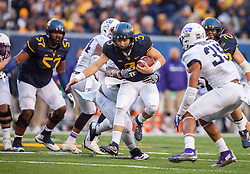 Oct 22, 2016; Morgantown, WV, USA; West Virginia Mountaineers quarterback Skyler Howard (3) runs the ball during the third quarter against the TCU Horned Frogs at Milan Puskar Stadium. Mandatory Credit: Ben Queen-USA TODAY Sports