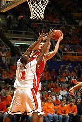 02 January 2004  Neil Plank meets Spears on his way up to the hoopl. Illinois State University ties up The Fightin Illini in regulation but fails to top the Big 10 team in overtime. Action took place at the Assembly Hall on the University of Illinois Campus in Champaign - Urbana Illinois.