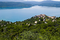 Lac de Sainte-Croix in southern France is a man-made lake formed as a result of the Barrage de Sainte-Croix dam. Les Salles-sur-Verdon was moved to higher ground. The original village is now completely underwater.