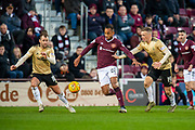 Loic Damour (#22) of Heart of Midlothian FC breaks between Niall McGinn (#10) and Lewis Ferguson (#19) of Aberdeen FC during the Ladbrokes Scottish Premiership match between Heart of Midlothian FC and Aberdeen FC at Tynecastle Stadium, Edinburgh, Scotland on 29 December 2019.