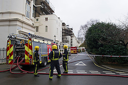 © London News Pictures. 22/01/2014. London, UK. A continued presence of Fire crews at the scene of a fire at a £3 million property on Hyde Park Gardens Muse, one of the most expensive street in London. The grade 2 listed building was gutted by a fire that started in the basement. Eight fire engines and 58 firefighters and officers attended the scene. There have been no reports of injuries. Photo credit: Ben Cawthra/LNP