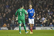 Portsmouth Goalkeeper, David Forde (1) and Portsmouth Defender, Christian Burgess (6) celebrate Portsmouth Forward, Noel Hunt (20) goal 2-0 during the EFL Sky Bet League 2 match between Portsmouth and Mansfield Town at Fratton Park, Portsmouth, England on 12 November 2016. Photo by Adam Rivers.