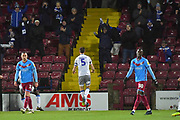 Colchester United player Luke Prosser(5) scores goal to go 2-2 during the EFL Sky Bet League 2 match between Scunthorpe United and Colchester United at Glanford Park, Scunthorpe, England on 14 December 2019.