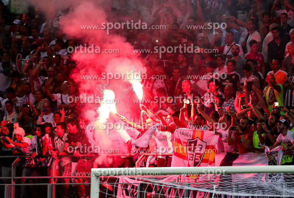 Supporters of Real Madrid celebrate after last penalty shot of Cristiano Ronaldo of Real Madrid at football match between Real Madrid (ESP) and Atlético de Madrid (ESP) in Final of UEFA Champions League 2016, on May 28, 2016 in San Siro Stadium, Milan, Italy. Photo by Vid Ponikvar / Sportida