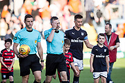 August 9th 2017, Dens Park, Dundee, Scotland; Scottish League Cup Second Round; Dundee versus Dundee United; Captain Cammy Kerr and mascots lead Dundee out for the derby