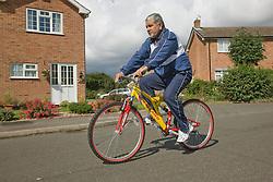 Older man riding a bicycle,