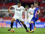 SEVILLE, SPAIN - OCTOBER 28:  Wissam Ben Yedder of Sevilla FC (L) competes for the ball with Ruben Perez of CD Leganes (R) during the La Liga match between Sevilla and Leganes at  Estadio Sanchez Pizjuan on October 28, 2017 in Seville, .  (Photo by Aitor Alcalde Colomer/Getty Images)