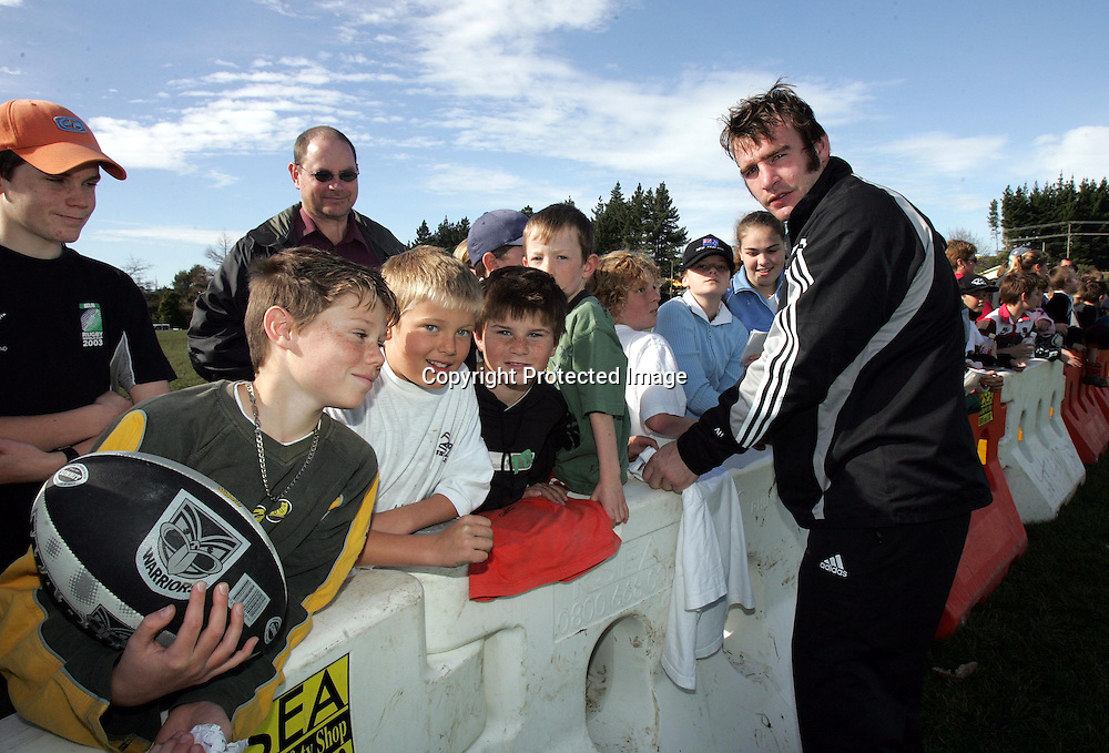 Andrew Hore signs autographs during the All Blacks training session at Silverdale United RFC, North of Auckland, New Zealand, Wednesday 7th July 2004. The All Blacks play the Pacific Islanders on Saturday.<br />