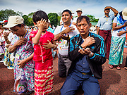 29 NOVEMBER 2017 - YANGON, MYANMAR:  People pray at the end of the Papal Mass in Yangon. Hundreds of thousands of Catholics from Myanmar attended the mass said by Pope Francis at Kyaikkasan Sports Ground in Yangon Wednesday. Pope Francis is on the first visit by a Pope to Myanmar.  PHOTO BY JACK KURTZ