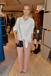 POLLY MORGAN at a dinner hosted by Tod's to celebrate the refurbishment of their store 2-5 Old Bond Street, London on 15th September 2016.