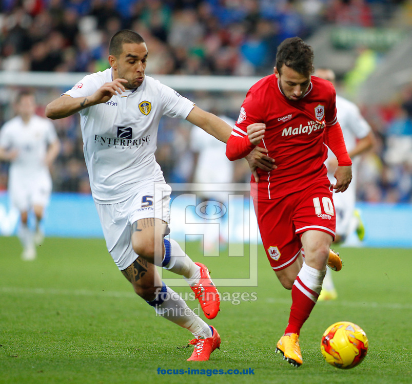 Adam Le Fondre of Cardiff City and Giuseppe Bellusci of Leeds United during the Sky Bet Championship match at the Cardiff City Stadium, Cardiff<br /> Picture by Mike  Griffiths/Focus Images Ltd +44 7766 223933<br /> 01/11/2014