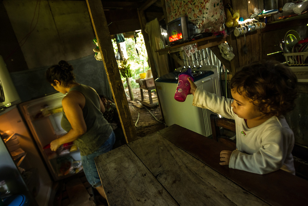 A young girl asks her mother for more water mixed with brown sugar for breakfast, in a  small town where a nearby pineapple industrial farm operates.  Residents believe their water to be contaminated because of environmental failures at the pineapple plantation.