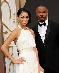 Corinne Bishop with Jamie Foxx arriving to the 2014 Oscars at the Hollywood and Highland Center in Hollywood, California, USA,  Sunday, 2nd March 2014. Picture by Hollywood Bubbles / i-Images<br /> UK ONLY