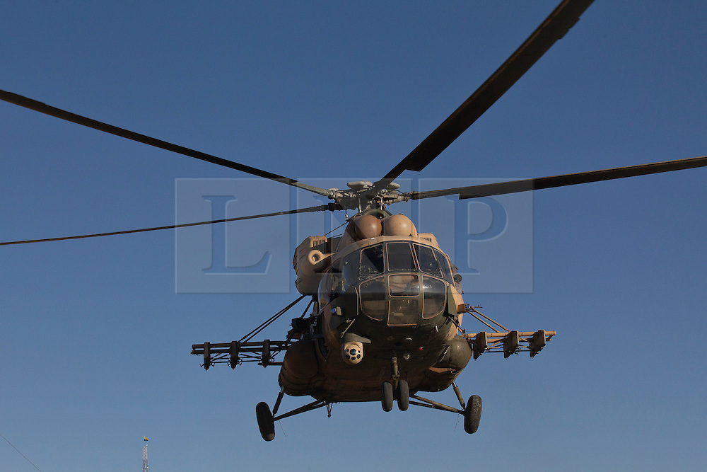 © Licensed to London News Pictures. 11/12/2014. Fishkhabour, Iraq. An Iraqi Air Force Mi-17 Hip helicopter comes in to land at an Iraqi-Kurdish peshmerga base in Fishkhabour before a mission to supply Yazidi refugees on Mount Sinjar.<br /> <br /> Although a well publicised exodus of Yazidi refugees took place from Mount Sinjar in August 2014 many still remain on top of the 75 km long ridge-line, with estimates varying from 2000-8000 people, after a corridor kept open by Syrian-Kurdish YPG fighters collapsed during an Islamic State offensive. The mountain is now surrounded on all sides with winter closing in, the only chance of escape or supply being by Iraqi Air Force helicopters. Photo credit: Matt Cetti-Roberts/LNP