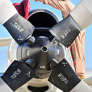 11/22/09 -- BRUNSWICK, Maine. U.S. Navy Petty Officer Andrew Wray of Patrol Squadron 26 (VP-26), based at Naval Air Station (NAS) Brunswick, removes the cover from one of a P-3's four turboprop engines on Sunday morning. VP-26 deployed one plane and a crew to Africa on Sunday. The squadron will deploy it's last two planes on Sunday, after Thanksgiving. Following the deployment, VP-26 will return to Jacksonville, Fla., because NAS Brunswick is slated to close in 2011.  VP-26 is the last squadron to leave NAS Brunswick. Photo by Roger S. Duncan
