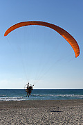 motor paragliding on the Mediterranean sea coast