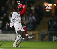 Photo: Paul Thomas.<br /> Blackburn Rovers v Basle. UEFA Cup. 02/11/2006.<br /> <br /> Blackburn's Shabani Nonda (Red) has a great shot a goal past Papa Malick BA, but is saved by the Basel keeper.