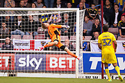 Fine save from AFC Wimbledon goalkeeper George Long (1), on loan from Sheffield United,  during the EFL Sky Bet League 1 match between Northampton Town and AFC Wimbledon at Sixfields Stadium, Northampton, England on 14 October 2017. Photo by Simon Davies.