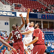 MOBILE, AL - DECEMBER 4:  Augustine Rubit #21 of the South Alabama Jaguars takes a shot over Bandja Sy #10 of the New Mexico State Aggies at USA Mitchell Center on December 4, 2012 in Mobile, Alabama. At halftime New Mexico State leads South Alabama 31-25. (Photo by Michael Chang/Getty Images) *** Local Caption *** Augustine Rubit;Bandja Sy