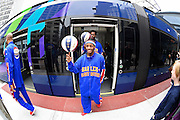 "Ty ""Turbo"" Davis leads the Harlem Globetrotters off the new Atlanta Streetcar at Woodruff Park during their 2.7-mile downtown tour and basketball handling skills demonstration in advance of a pair of the team's upcoming shows at the Arena at Gwinnett, on Monday, March 9, 2015, in Atlanta. David Tulis / AJC Special"