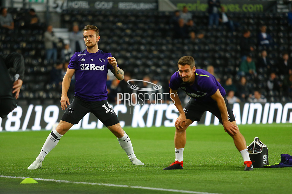 Derby County midfielder Craig Bryson (4) and Derby County forward Jack Marriott (14) warm up during the EFL Sky Bet Championship match between Derby County and Blackburn Rovers at the Pride Park, Derby, England on 18 September 2018.