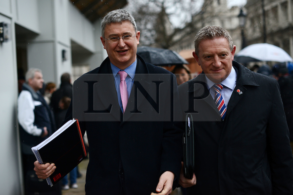 © Licensed to London News Pictures.18/02/2014. London, UK. Paul Evans, Group CEO at AXA (L) and David Williams, AXA Managing Director leaving the Cabinet Office where insurance chiefs met with ministers. Photo credit : Peter Kollanyi/LNP
