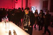 Guests attending the event organized to launch a new model of sneaker by Adidas - EQT - at Over Studio in Milan, Italy, on January 25, 2017. Music by The Perseverance Ghali Raye, turbo red light installation by Quiet Ensemble. &copy; Carlo Cerchioli<br /> <br /> Invitati partecipano all'evento organizzato per il lancio di un nuovo modello di sneaker di Adidas - EQT - al Over Studio a Milano, 25 gennaio 2017. Musiche di The Perseverance Ghali Raye, installazione turbo red light di Quiet Ensemble.