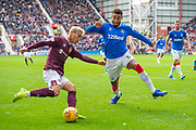 Connor Goldson (#6) of Rangers FC tries to prevent a cross from Ryotaro Meshino (#77) of Heart of Midlothian FC during the Ladbrokes Scottish Premiership match between Heart of Midlothian and Rangers FC at Tynecastle Park, Edinburgh, Scotland on 20 October 2019.
