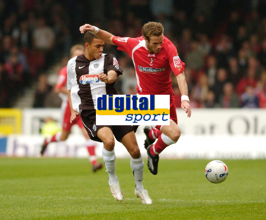Photo: Leigh Quinnell.<br /> Swindon Town v Grimsby Town. Coca Cola League 2. 14/10/2006. Swindons Andy Monkhouse jumps a challenge by Grimsbys Peter Bore.