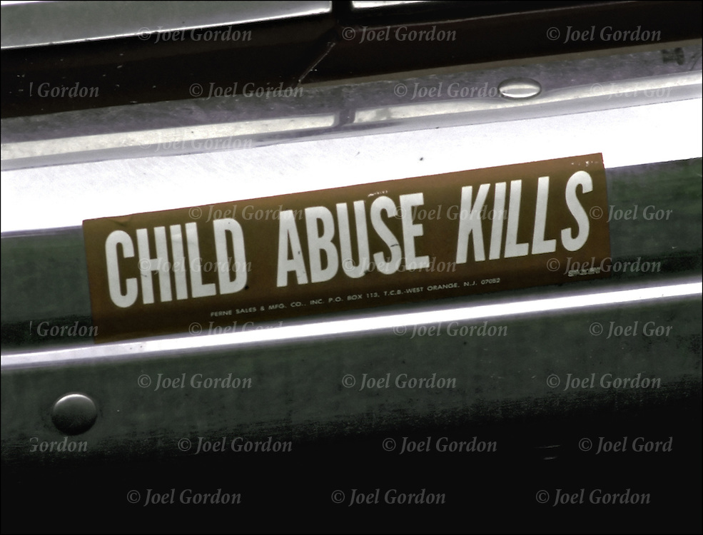Bumper sticker on back of car - Child Abuse Kills