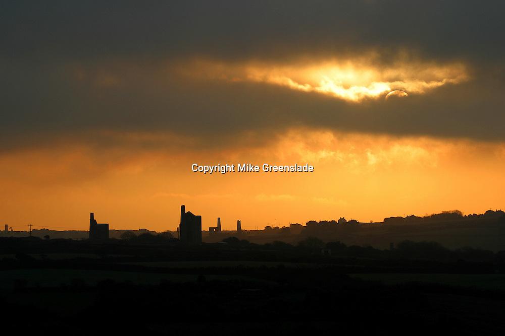Sunset over old engine houses nearCarn Brea, Redruth, Cornwall, UK