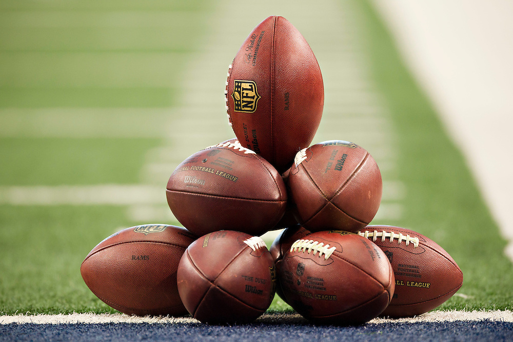 ARLINGTON, TX - OCTOBER 23:   NFL Footballs stacked up on the field before a game between the Dallas Cowboys and the St. Louis Rams at the Cowboy Stadium on October 23, 2011 in Arlington, Texas.  The Cowboys defeated the Rams 34 to 7.  (Photo by Wesley Hitt/Getty Images) *** Local Caption ***